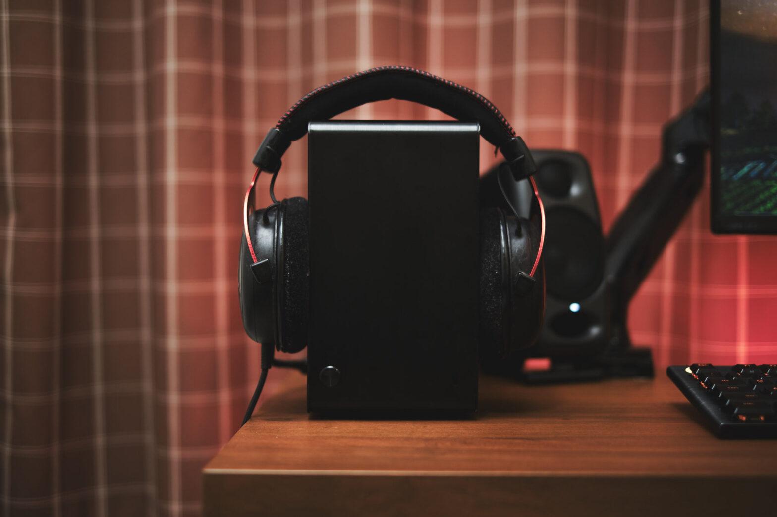 DAN A4 case size comparison with a headphone